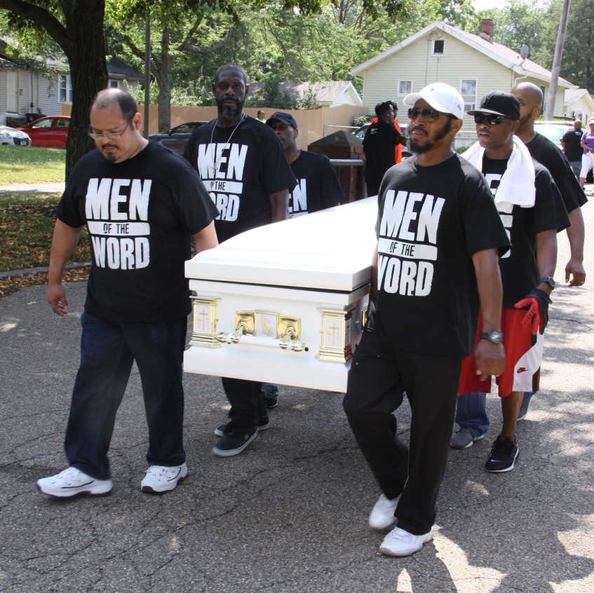 Marchers carried caskets around the East Akron Neighborhood in protest of the rise in drug and gun violence.