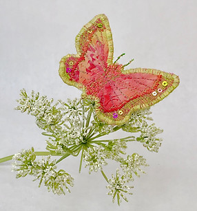 Coral and lime green brooch