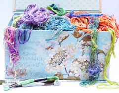 A coloured box of hand threads