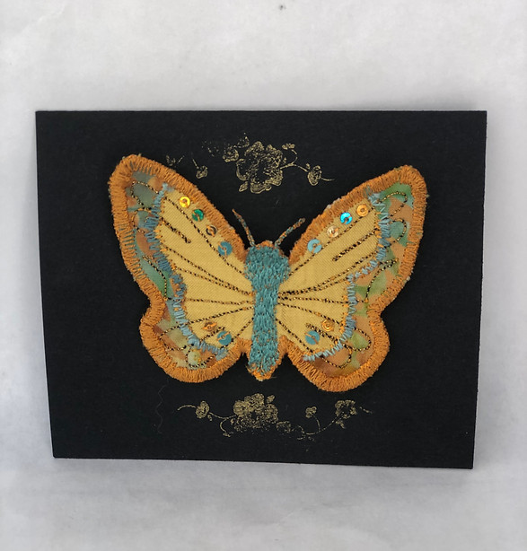 Gold and turquoise brooch on card
