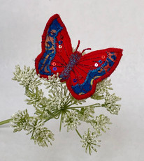 Red and blue brooch