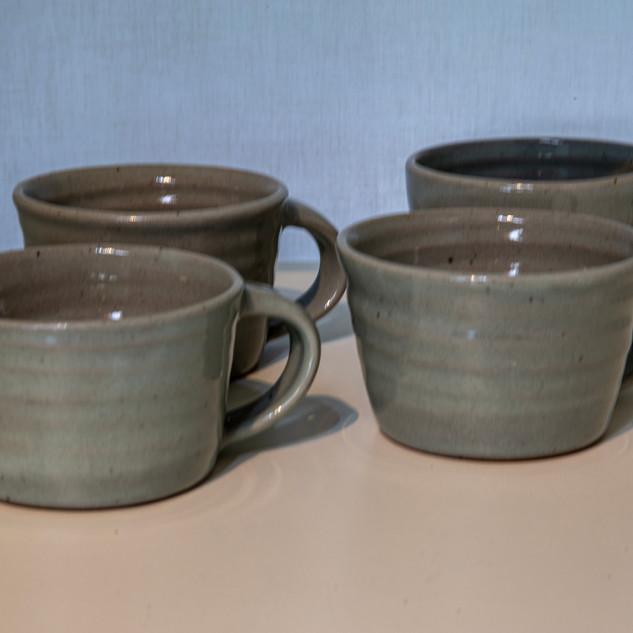 Kate McKay, four cups, celadon glaze.
