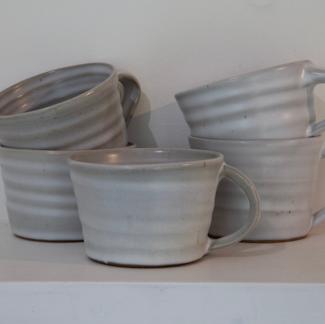 47.Kate McKay, five cups, dark stoneware, satin matt glaze