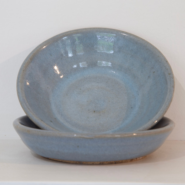 42.Al Howard, two dark stoneware dishes, chun glaze