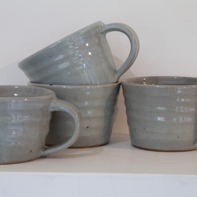 39.Al Howard, three cups, dark stoneware, chun glaze