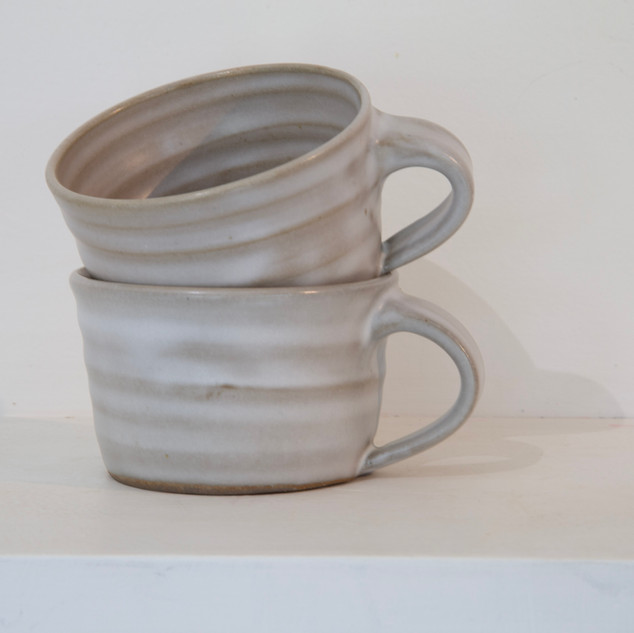 41.Kate McKay, two cups, dark stoneware, satin matt glaze.