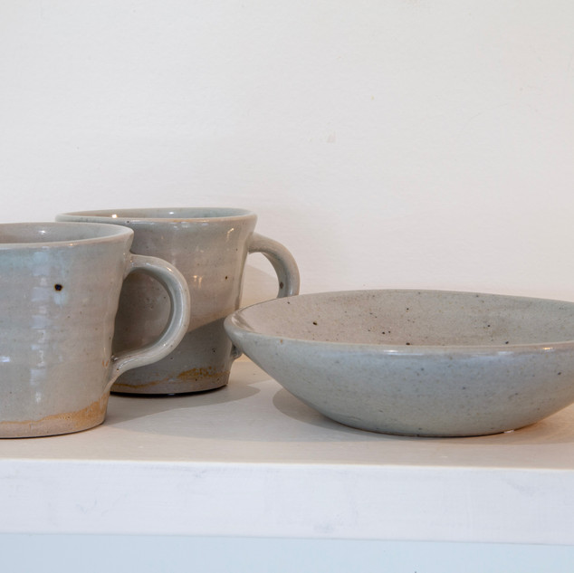 38.Al Howard, two cups and shallow dish, celadon glaze