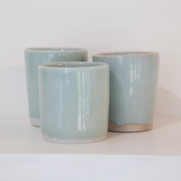 43.Al Howard, three beakers, Limoges porcelain, celadon glaze