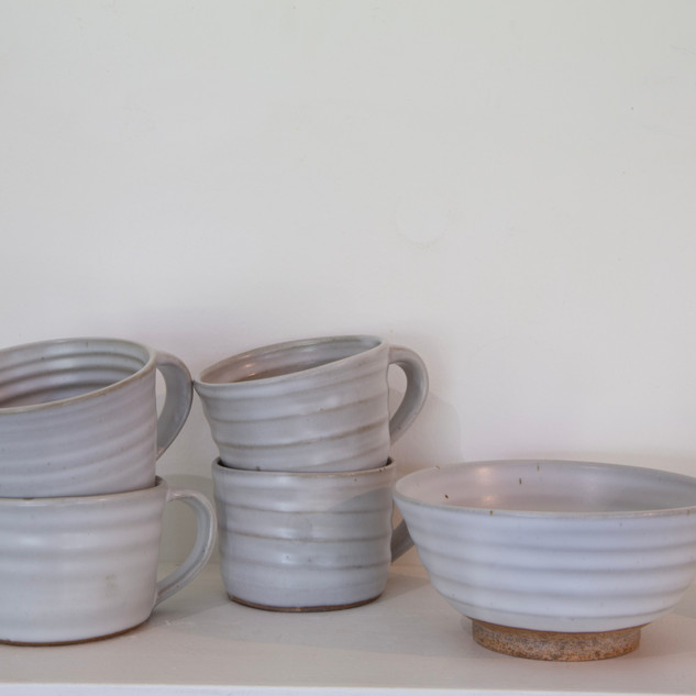 48.Kate McKay, four cups, one bowl, dark stoneware, satin matt glaze