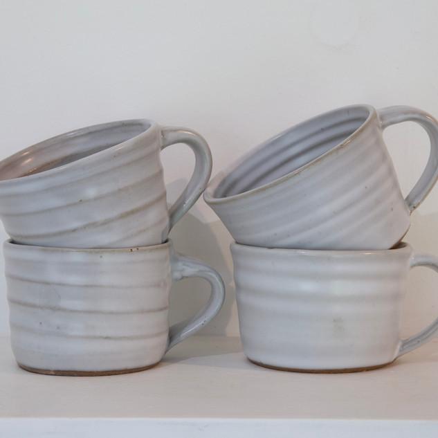 45.Kate McKay, four cups, dark stoneware, satin matt glaze