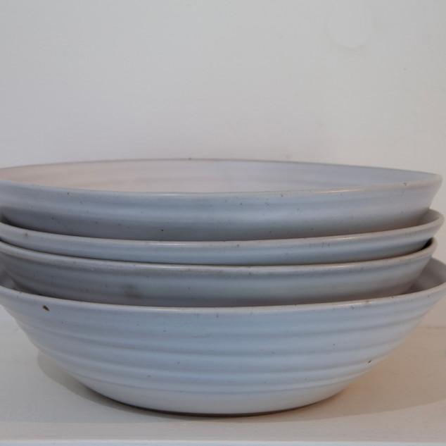23.Kate McKay, four deep bowls, stoneware, satin matt glaze