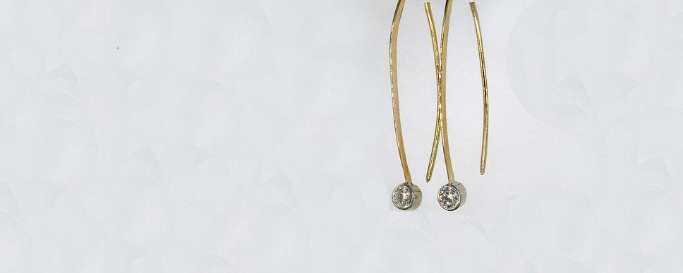 earrings gold pear shaped header.jpg