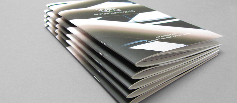 What is the difference between saddle stitch and perfect binding?