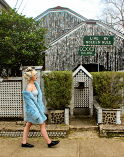 model in front of Beer can house