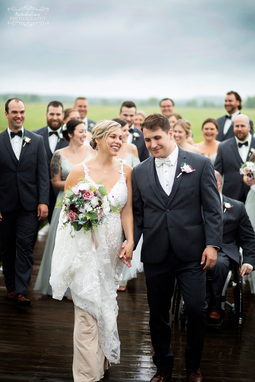 Ashley and Zack's wedding had rain most of the day.  They were still able to get some outside bridal party photos. One of the groomseman is in a wheelchair but was still able to get around the barn easily.