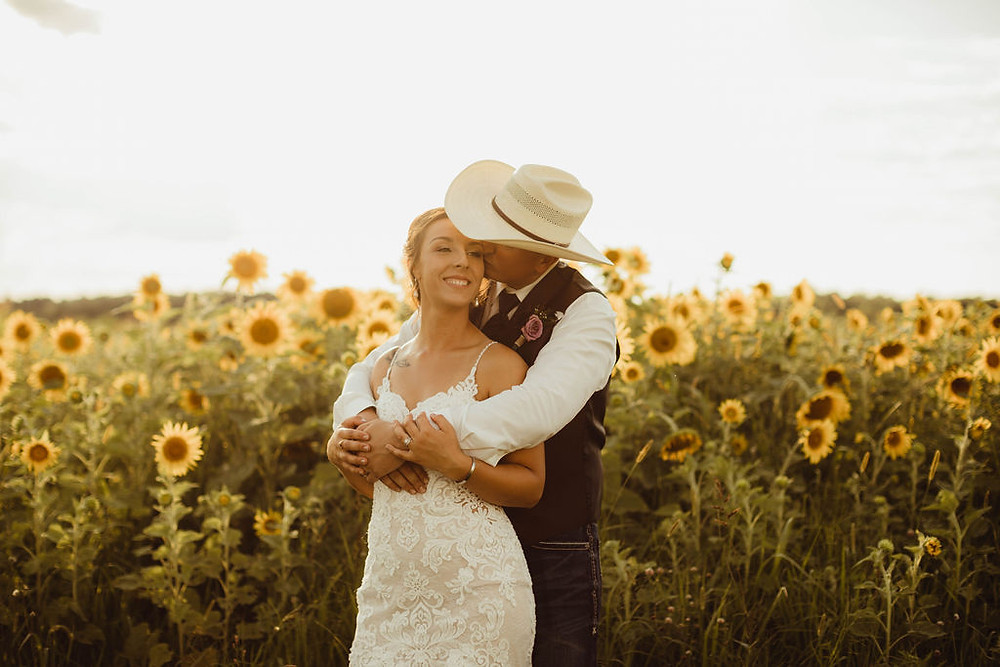 Bride and Groom in front of sunflowers