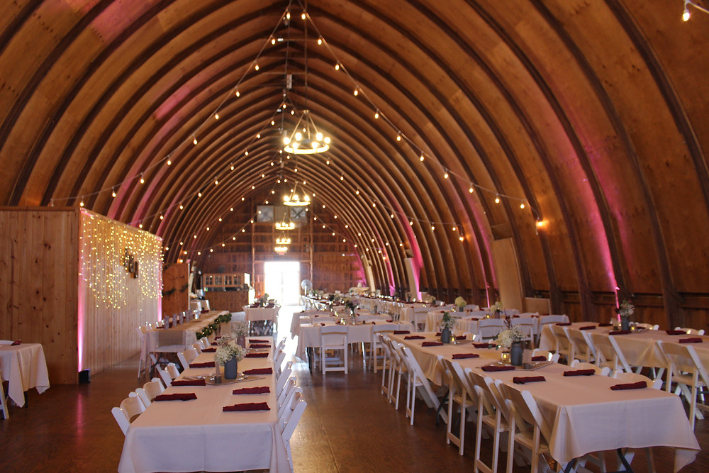Inside of the barn set-up for wedding reception.