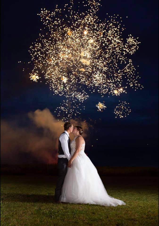 Bride and groom with fireworks.