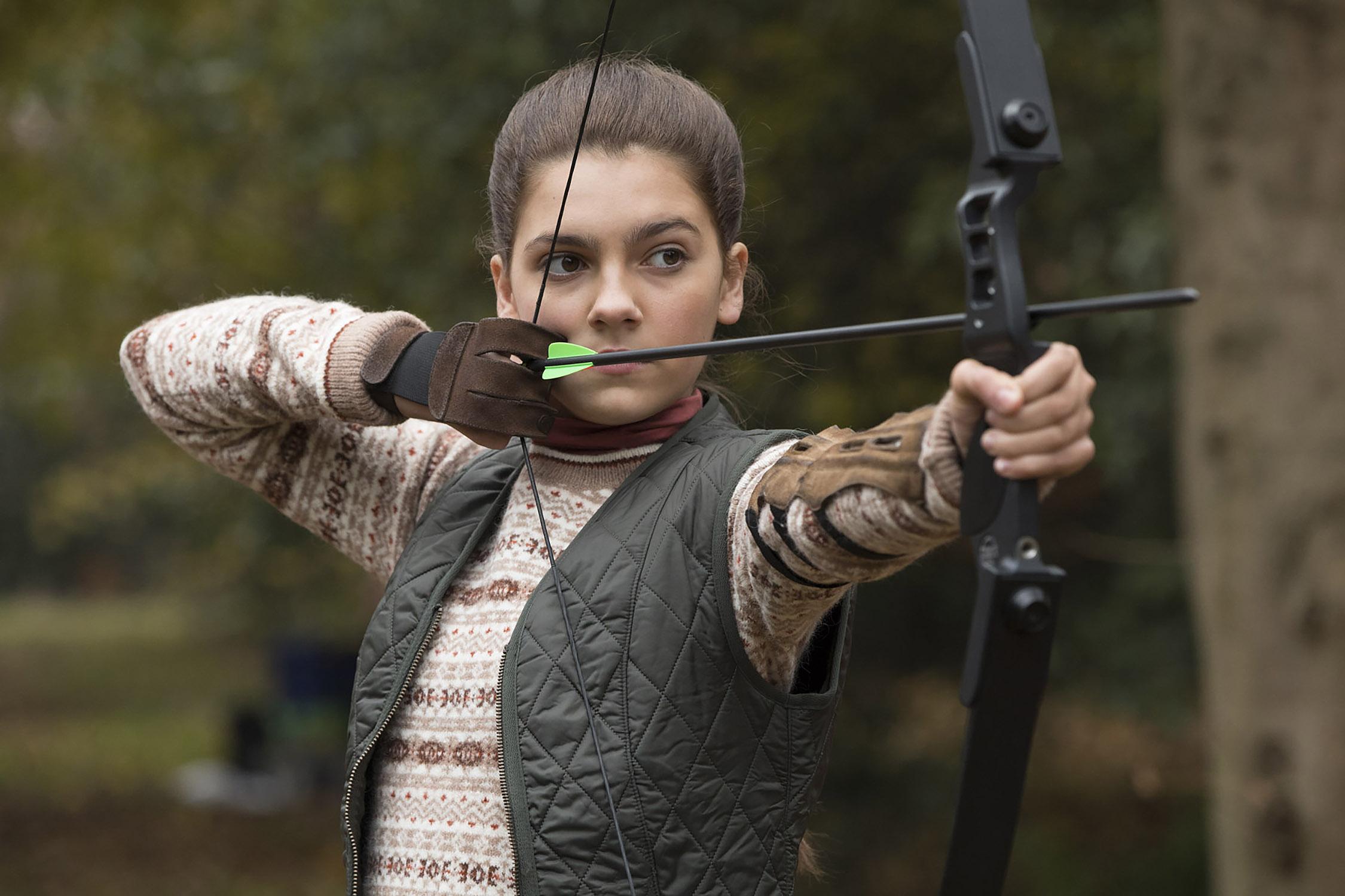 Emily Carey as Young Lara Croft