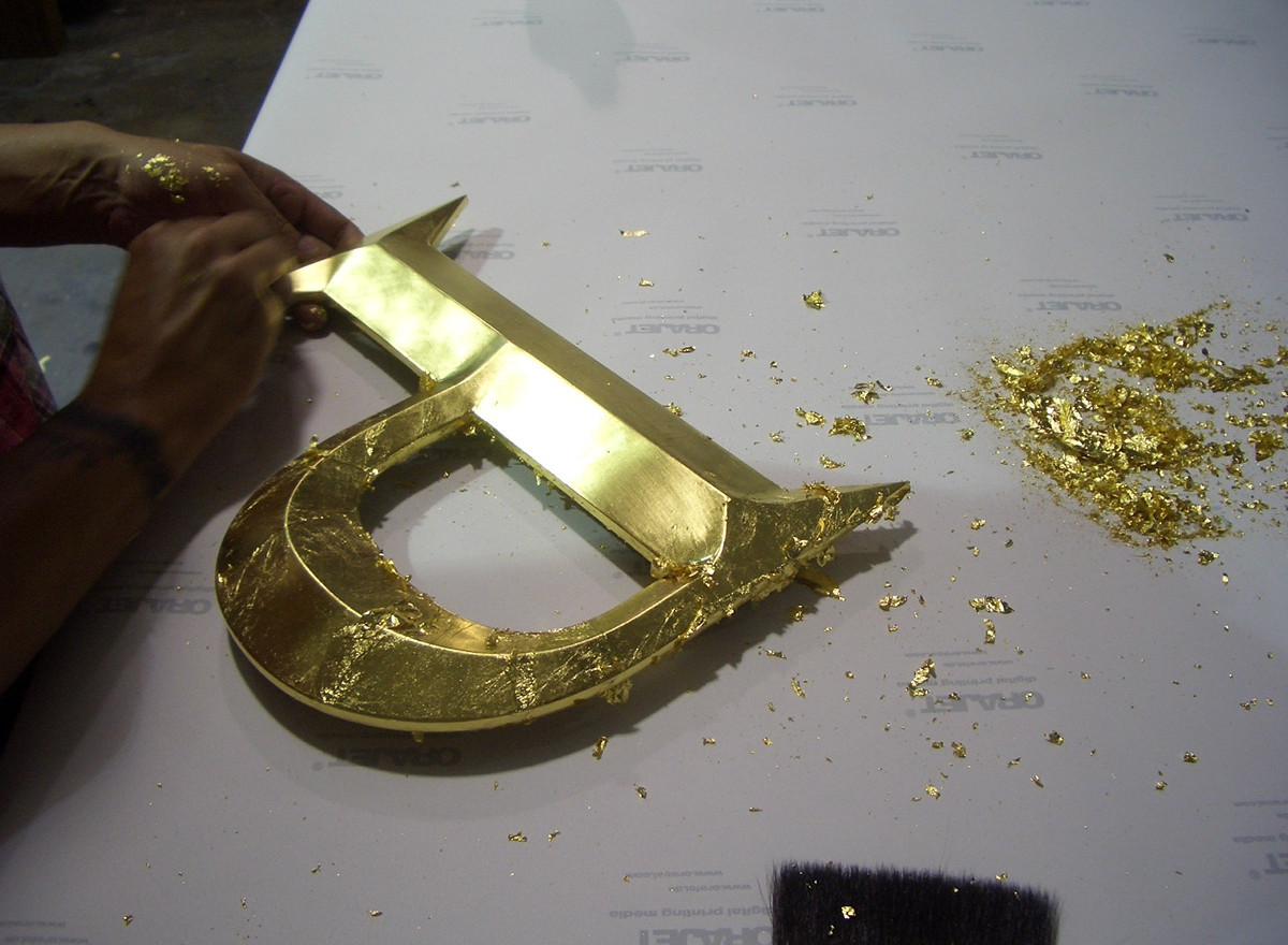 The final step of burnishing the gold with cotton to make it smooth and shiny.