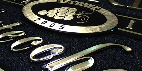 The center plaque is finished with flat, burnished leaf.