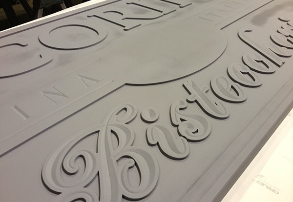 Several coats of automotive type primer are applied to the foam and hand sanded to a smooth finish prior to painting.