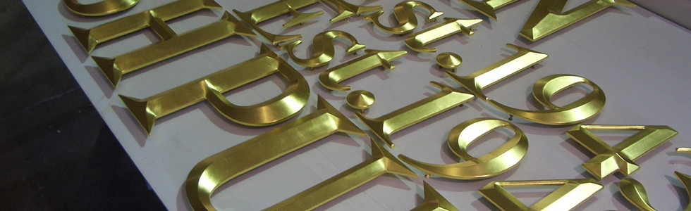 A batch of finished letters. It's a time consuming process, but nothing compares to the lasting beauty of genuine gold leaf.
