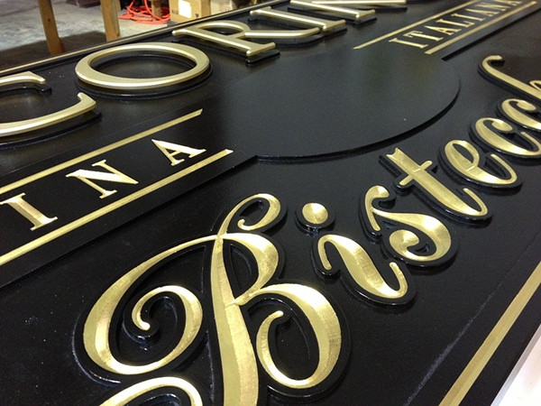 After polishing the gilded letters to a bright finish, we remove the mask.