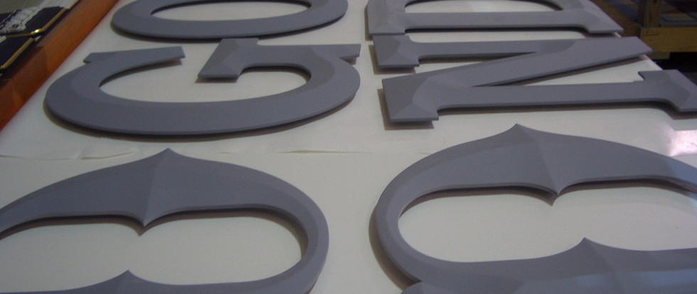 """Some 24"""" letters primed, sanded and ready for painting."""