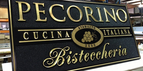 The finished sign with a combination of raised and carved letters.