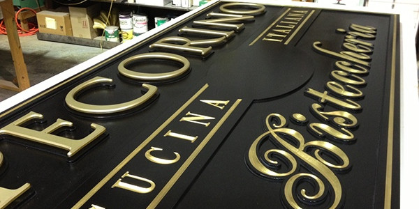 In the next step, we will fill in the recessed areas around the letters with crushed black glass to add an interesting texture that will compliment the gold leaf.