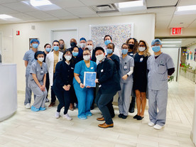 GFG New York medical team in front of JY&A New York art donation