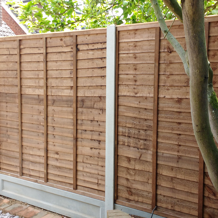Completed run of Waney Lap panel Fencing