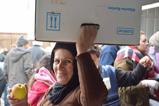 Distributing aid to refugees