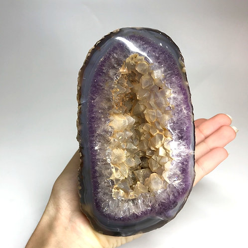 Naural Amethyst in Agate Geode with golden quartz points from Madagascar