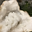 Thumbnail: White Quartz Geode with flowers growing on the outside from Morocco