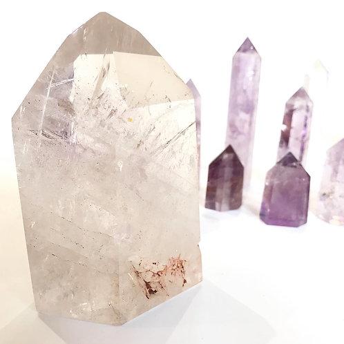 Clear quartz tower with amethyst