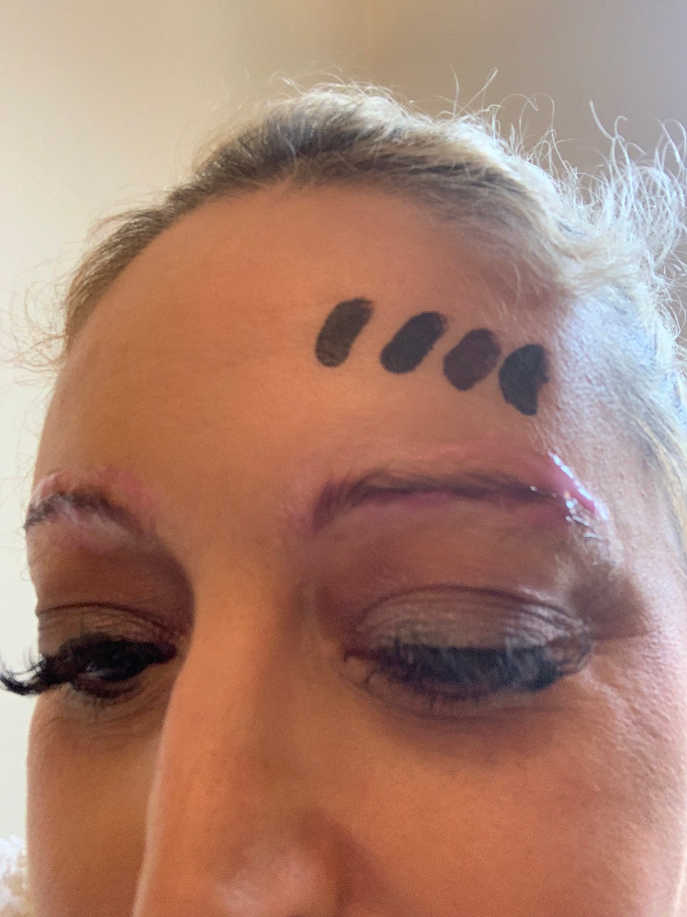 My eyebrows before microblading- numbing cream applied and colour matching.