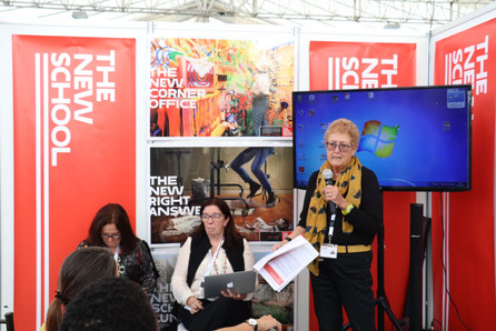 Caroline Moser presenting at The New School Exhibition Booth.
