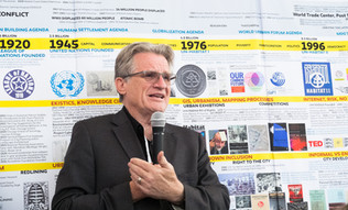 Bill Morrish presenting at The New School Exhibition Booth.