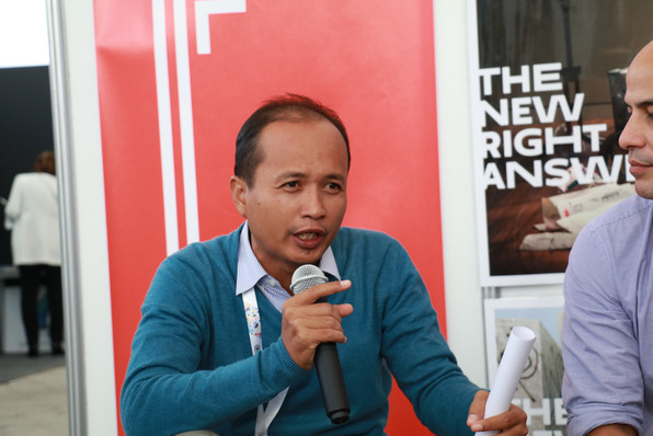 Ahmad Rifai presenting at The New School Exhibition Booth.