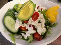 Arugula, cucumber, avocado, mago and tomato with house made blue cheese dressing. Optional bacon.