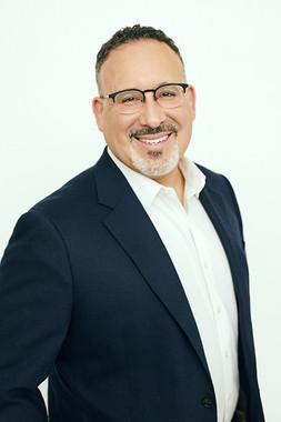 Dr. Miguel A. Cardona