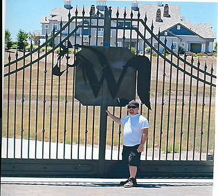 owner in front of steel gate