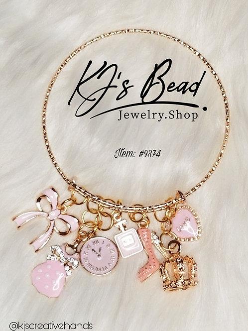 Gold Bangle Bracelet  - 7 Pink Charms