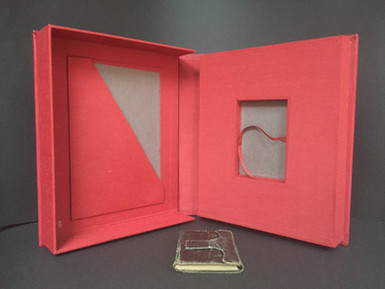 Clamshell interior with presentation inset and pocket for accompanying documents