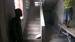 down internal stair case pending dressing.JPG