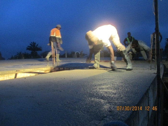 9 pm pouring of concrete completed.