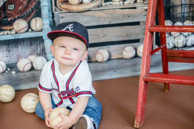 Photo of toddler boy in baseball gear