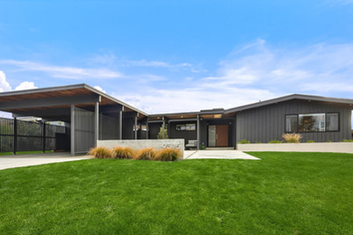 midcentury modern house with carport